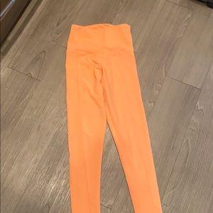Onzie bright orange leggings